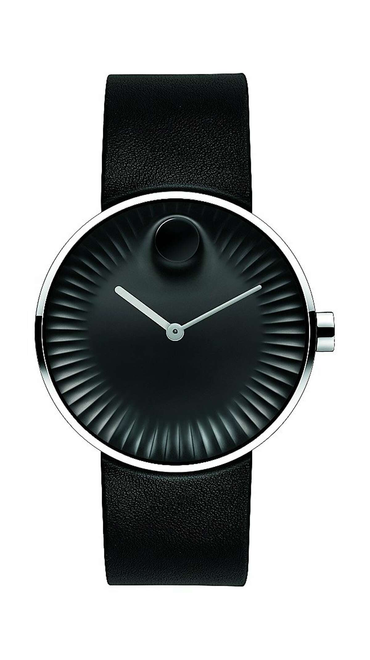 Swiss watchmaker Movado and industrial designer Yves Behar have collaborated on a new timepiece collection called Movado Edge.(( FOLLOWED BY INDIVIDUAL DETAILS BELOW.)) Name: Movado Edge SKU: 3680002 Materials: 40 mm polished stainless steel case, concave sandblasted black aluminum dial with raised polished tonal dot, sculpted ray-textured edge, matte gray hour hand and glossy gray minute hand, black rubber strap with polished stainless steel tongue buckle. Price: $495. Credit: Movado