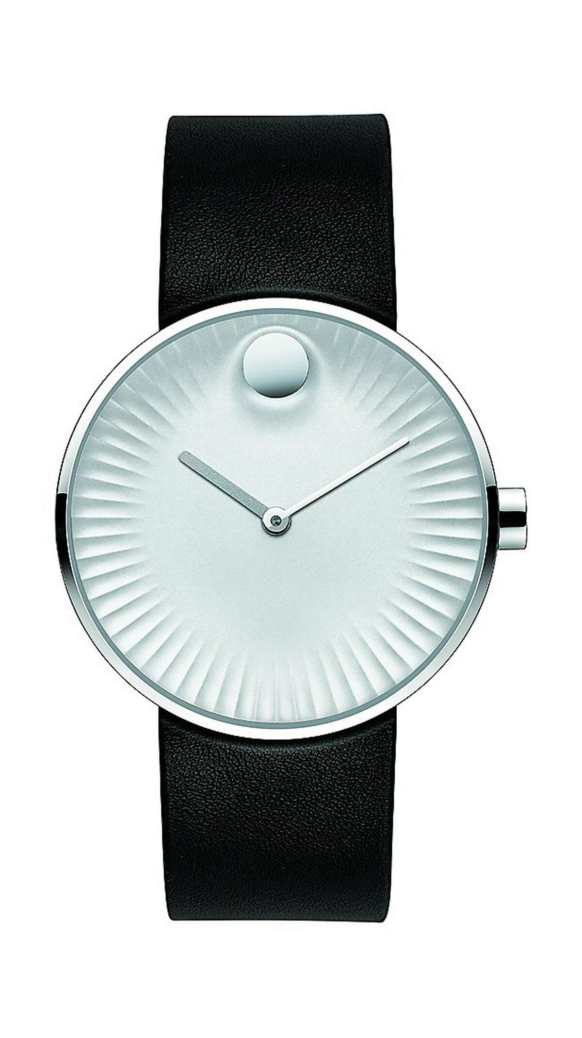 Swiss watchmaker Movado and industrial designer Yves Behar have collaborated on a new timepiece collection called Movado Edge.(( FOLLOWED BY INDIVIDUAL DETAILS BELOW.)) Name: Movado Edge SKU: 3680001 Materials: 40 mm polished stainless steel case, concave sandblasted silver-toned aluminum dial with raised polished tonal dot, sculpted ray-textured edge, matte silver-toned hour hand and polished silver-toned minute hand, black rubber strap with polished stainless steel tongue buckle. Price: $495. Credit: Movado