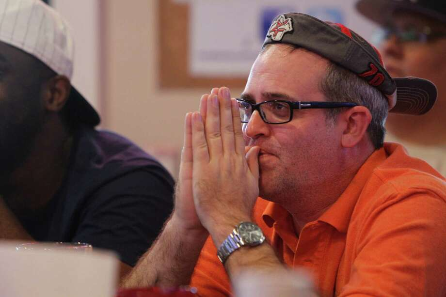 """""""I'm stressing"""" said Astros fan Steven Goeckler as he watched action in the bottom of the 8th inning Friday at Pluckers. Photo: Steve Gonzales, Houston Chronicle / © 2015 Houston Chronicle"""