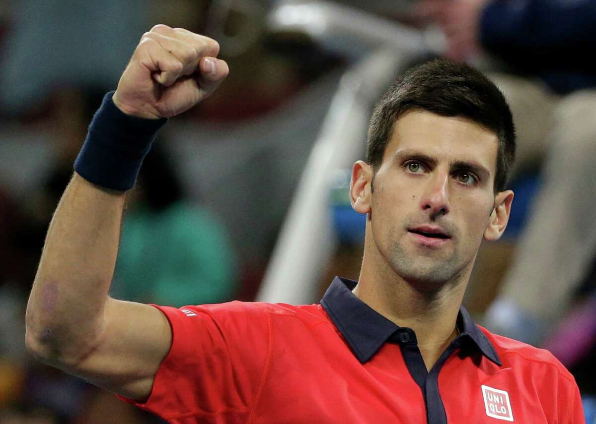 Novak Djokovic of Serbia celebrates after defeating John Isner of the United States in the men's singles quarterfinal match of the China Open tennis tournament at the National Tennis Stadium in Beijing, Friday, Oct. 9, 2015. (AP Photo/Andy Wong) ORG XMIT: XAW137