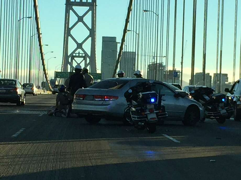 A short police pursuit ended after the suspect crashed his vehicle into another car going westbound on the Bay Bridge, temporarily blocking three lanes. Photo: Nanette Asimov