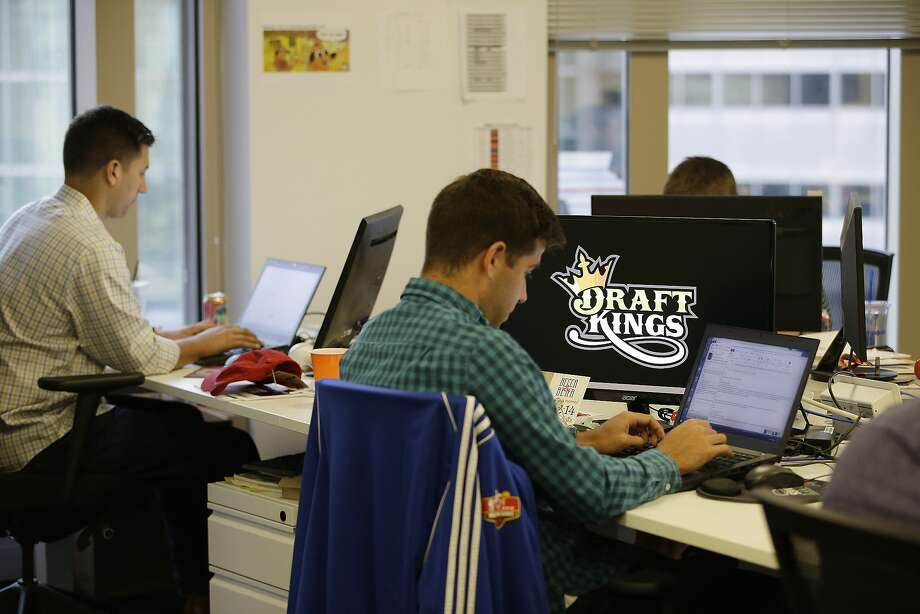 Bear Duker, a marketing manager for strategic partnerships at DraftKings, works at his computer in Boston. Photo: Stephan Savoia, Associated Press