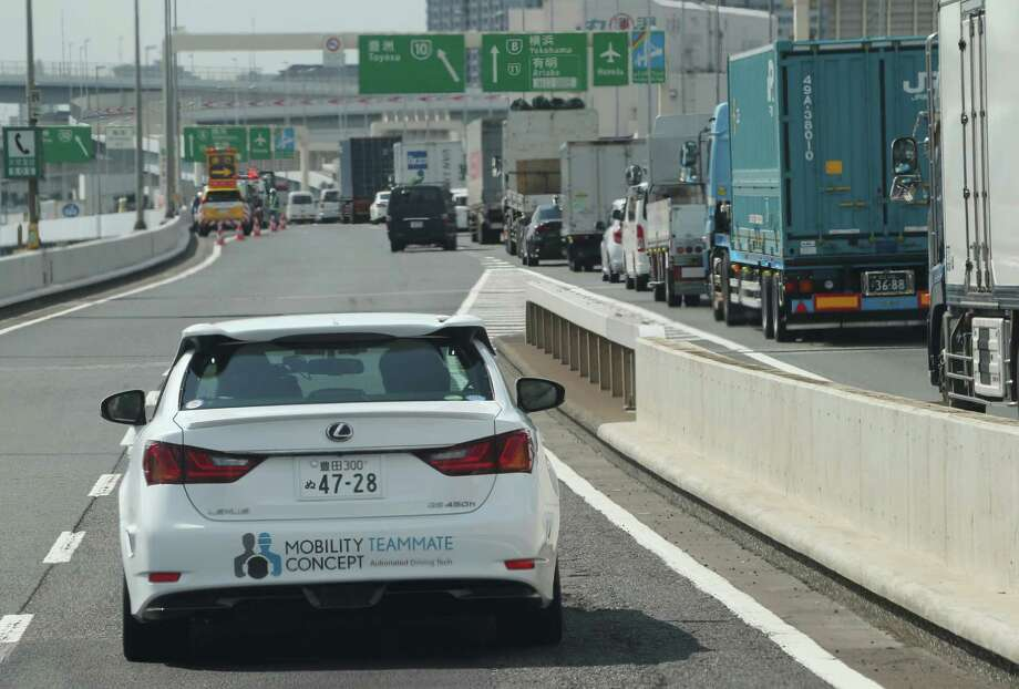 "Toyota's automated driving test vehicle, a Lexus GS, enters a highway on-ramp in Tokyo. Its ""teammate"" concept is aimed at keeping the driver involved. Photo: Koji Sasahara /Associated Press / AP"