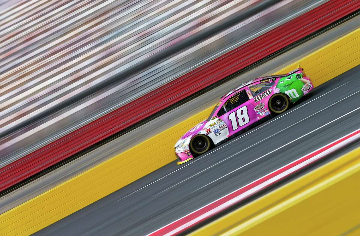CHARLOTTE, NC - OCTOBER 09: Kyle Busch, driver of the #18 M&M's Pretty In Pink Foundation Toyota, drives during practice for the NASCAR Sprint Cup Series Bank of America 500 at Charlotte Motor Speedway on October 9, 2015 in Charlotte, North Carolina. (Photo by Jonathan Ferrey/Getty Images) ORG XMIT: 583731125