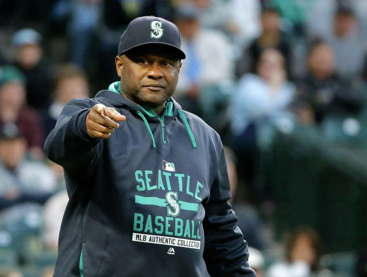 FILE - In this Oct. 3, 2015, file photo, Seattle Mariners manager Lloyd McClendon points towards first base while questioning an umpire's call in the first inning of a baseball game against the Oakland Athletics in Seattle. The Mariners have fired manager Lloyd McClendon after two seasons, Friday, Oct. 9, 2015, less than a week after the Mariners concluded a disappointing 76-86 season.(AP Photo/Ted S. Warren, File) ORG XMIT: NY172
