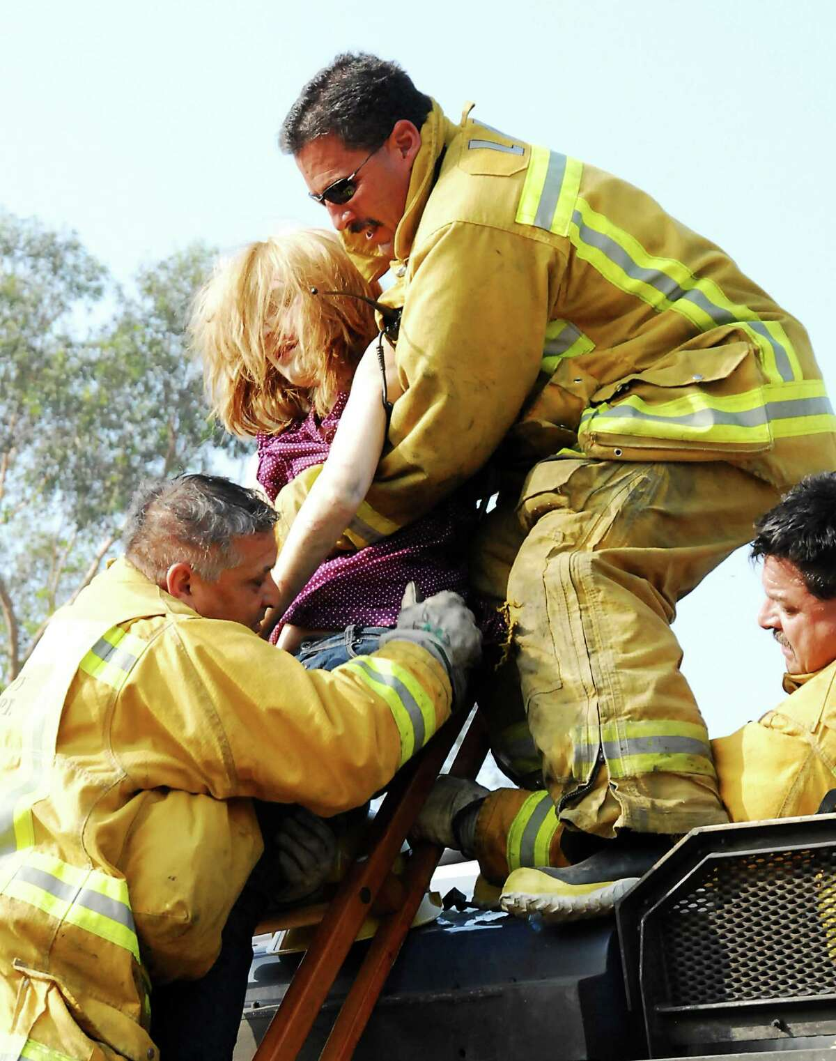 Los Angeles City Fire Department firefighters rescue a victim from the wreckage of a Metrolink commuter train after a train crash in the Chatsworth area of Los Angeles on Friday, Sept. 12, 2008.(AP Photo/Ryan Ling)
