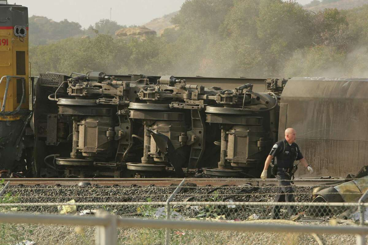 Train cars are seen overturned after an accident between a Union Pacific and Metrolink Amtrak train collision on Friday Sept. 12, 2008 in Chatsworth, Calif. A Metrolink commuter train believed to be carrying up to 350 people collided with a freight train Friday, killing two people and injuring an unknown number of others. (AP Photo/Mark Davis)