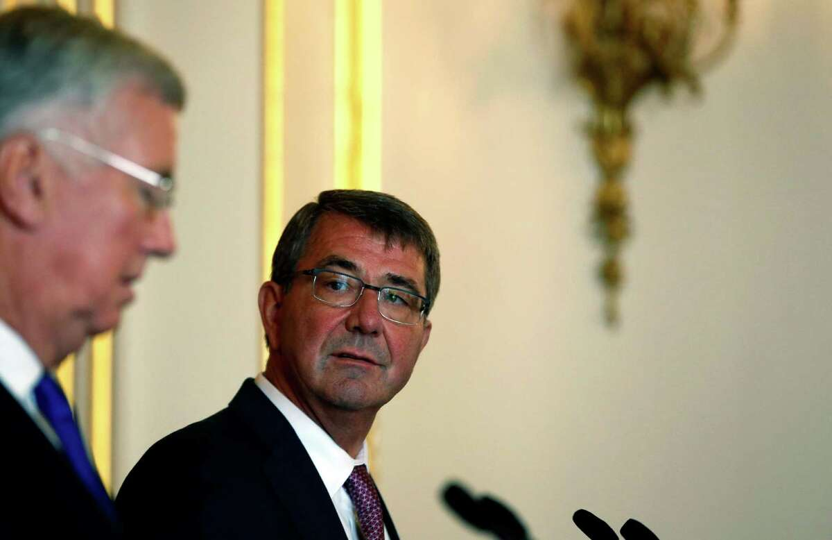 Britain's Secretary of State for Defence Michael Fallon, left, speaks during a press conference held with the U.S. Secretary of Defense Ashton Carter at Lancaster house in London, Friday, Oct. 9, 2015. (AP Photo/Alastair Grant) ORG XMIT: XAG111