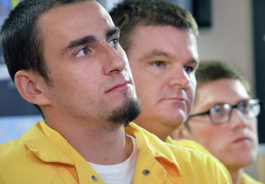 Albany County Jail inmate, from left, Joshua Molenaar of Schoharie, Timothy Hammond of Albany and Ryan Rhodes of Albany listen to Sheriff Craig Apple discuss plans to convert a wing of the Albany County Jail into a drug treatment facility during a new conference at the jail Friday Oct. 9, 2015 in Colonie,NY. (John Carl D'Annibale / Times Union)