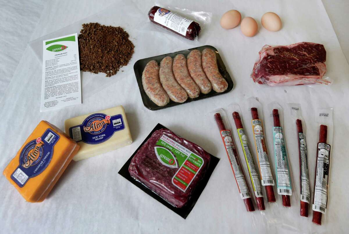 In this Oct. 1, 2015, photo, a variety of products with omega-3 fatty acids is shown at GreatO Premium Foods' facility in Manhattan, Kan. The company is has been experimenting with feeding a special flaxseed supplement, shown upper left, to cattle, chickens and pork to produce meat, egg, and dairy products with the healthy fat. (AP Photo/Charlie Riedel)