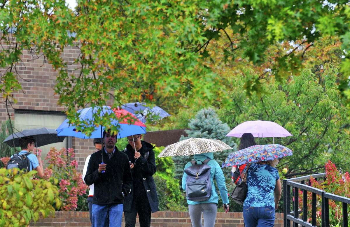 Umbrellas were the equipment of choice on the RPI campus and throughout most the Capital District on Friday Oct. 9, 2015 in Troy, N.Y. (Michael P. Farrell/Times Union)