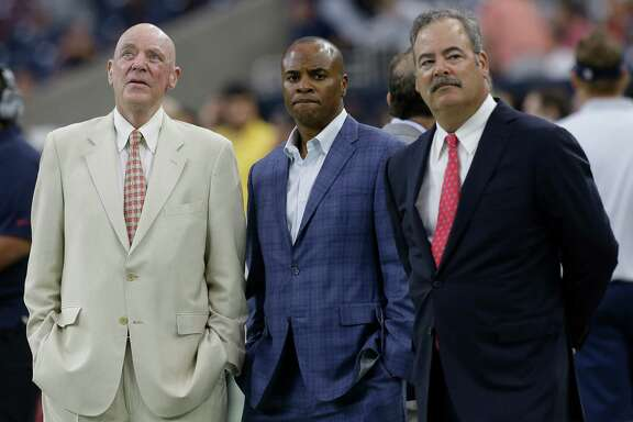 Houston Texans owner Bob McNair, left, stands with general manager Rick Smith and Cal McNair, chief operating officer, stand on the sidelines before the Texans' NFL pre-season football game against the San Francisco 49ers at NRG Stadium on Saturday, Aug. 15, 2015, in Houston. ( Brett Coomer / Houston Chronicle )