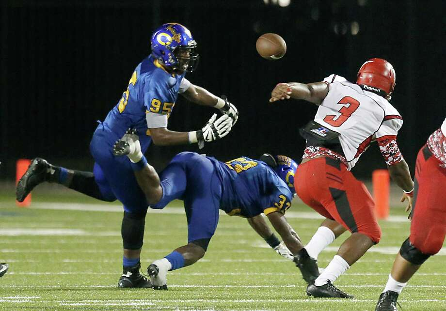 North Shore Mustangs quarterback Maciah Long (3) fumbles the ball to  Channelview Falcons defensive end Darrien Archie (95) who then fumbles the ball and was recovered by a North Shore lineman in the second half at Ray Maddry Stadium on Friday, October 9, 2015 in Channelview Texas. Northshore won 23 to 14. Photo: Thomas B. Shea, For The Chronicle / © 2015 Thomas B. Shea