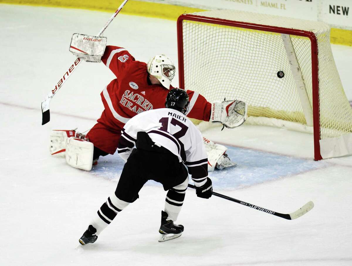 Union's Cole Maier (17)Êscores against Sacred Heart goaltender Brett Magnus (33) in the first period of an NCAA college hockey game Friday, Oct 9, 2015, in Schenectady, N.Y. (Hans Pennink / Special to the Times Union) ORG XMIT: HP101