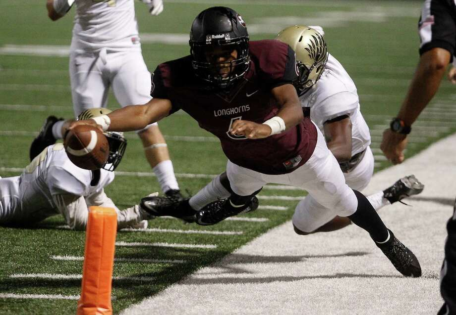 George Ranch's Alex Fontenot (6) dives to the 1-yard line during the second half of a high school football game against Foster at Traylor stadium on Friday, Oct. 9, 2015, in Rosenberg. Photo: J. Patric Schneider, For The Chronicle / © 2015 Houston Chronicle