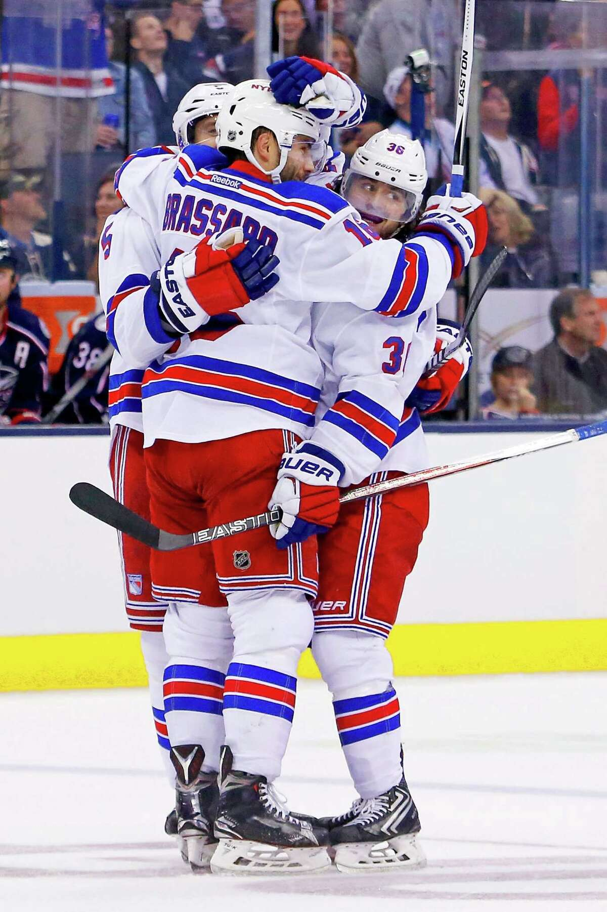COLUMBUS, OH - OCTOBER 9: Dan Girardi #5 and Derick Brassard #16 congratulate Mats Zuccarello #36, all of the New York Rangers after scoring his second goal of the game against the Columbus Blue Jackets during the third period on October 9, 2015 at Nationwide Arena in Columbus, Ohio. New York defeated Columbus 4-2. (Photo by Kirk Irwin/Getty Images) ORG XMIT: 574711547