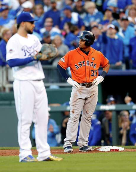 Astros outfielder Carlos Gomez (30) was originally called safe, but a replay review showed Royals closer Wade Davis picked him off first base. Photo: Karen Warren, Staff / © 2015 Houston Chronicle