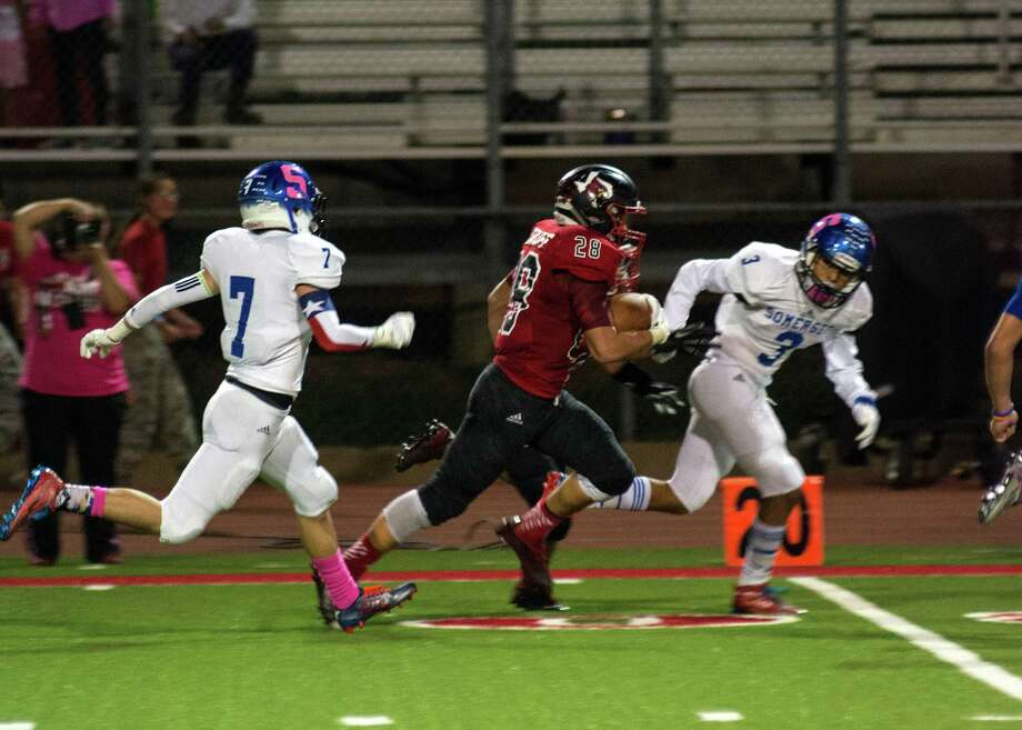 Southside running back Nathan Rosokoff breaks free for a huge gain while being chased by Somerset's Matthew Pinon and Jon Guevara on Friday. Oct. 9, 2015. Photo: Jena Stopczynski