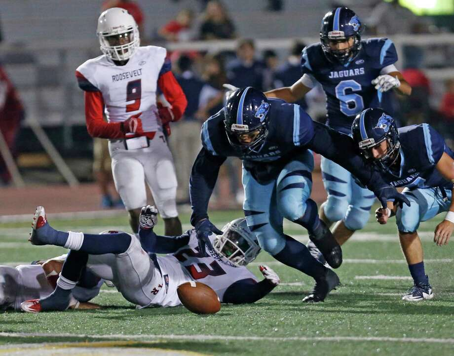 Roosevelt Joshua Morgan watches his fumble being recovered eventually by Johnson's Jack Scarborough, not in frame. District 26-6A high school football game between Roosevelt and Johnson at Comalander Stadium on Friday, October 9, 2015. Photo: Ron Cortes, Freelancer / For The San Antonio / Express-News
