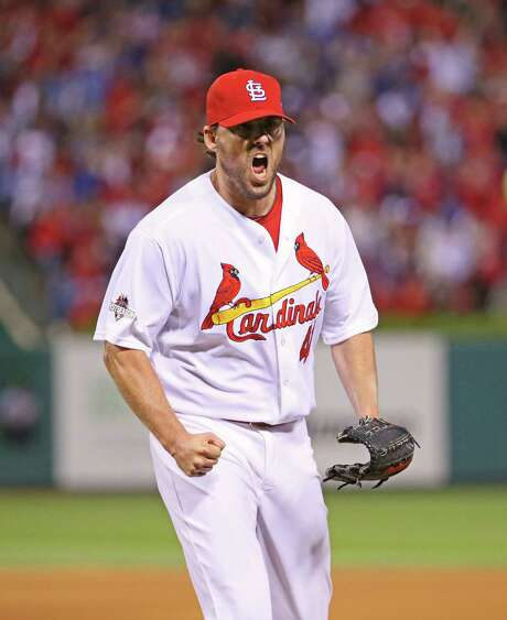 Cardinals pitcher John Lackey was fired up after tossing 71⁄3 scoreless innings against the Cubs. Photo: Chris Lee, MBR / St. Louis Post-Dispatch
