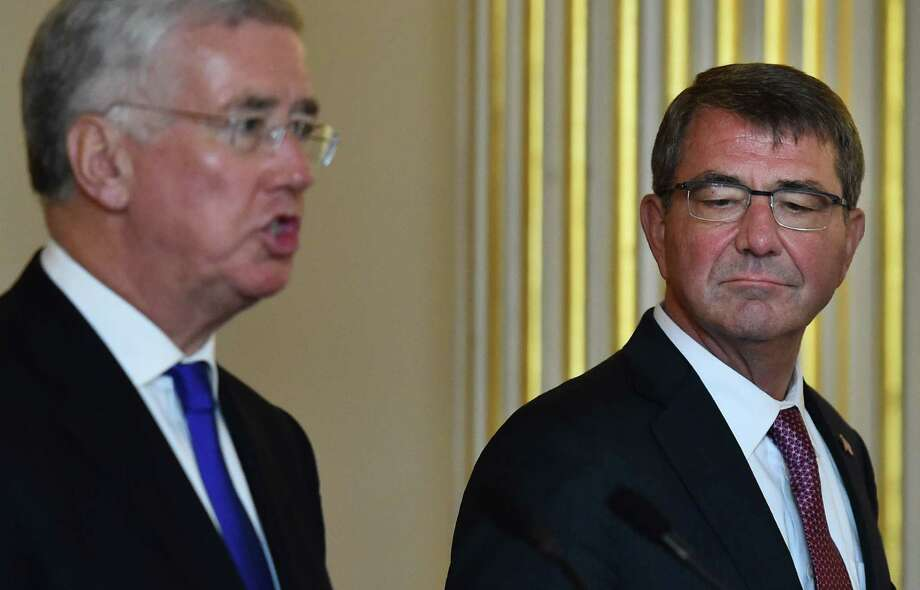 British Defence Secretary Michael Fallon (L) speaks as US Secretary of Defense Ashton Carter (R) listens at a joint press conference at Lancaster House in central London on October 9, 2015. The Pentagon-run programme to train and equip moderate Syrian rebels to fight Islamic State jihadists is being overhauled, US officials said October 9. Speaking at a news conference in London, Defence Secretary Ashton Carter said he had been dissatisfied with the effort, which suffered disastrous blows in its early days. AFP PHOTO / BEN STANSALLBEN STANSALL/AFP/Getty Images Photo: BEN STANSALL, Staff / AFP / Getty Images / AFP