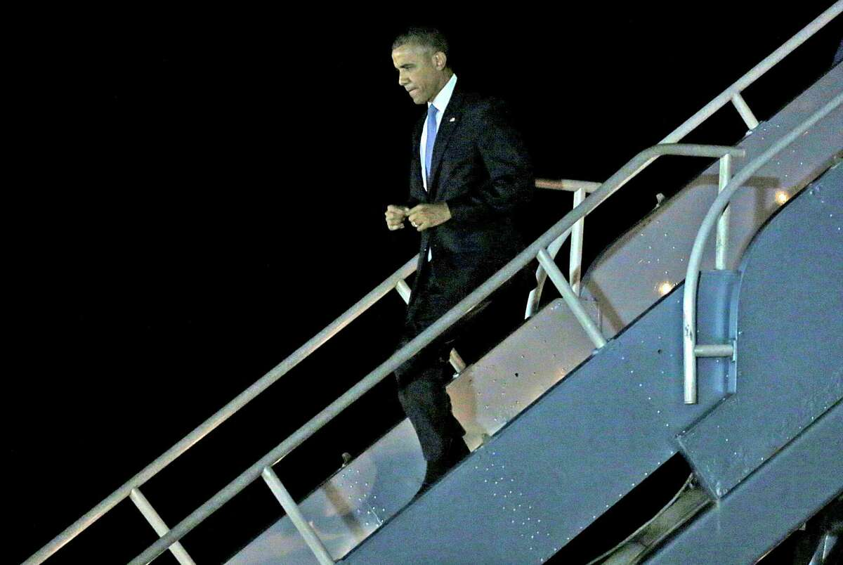 President Barack Obama steps off Air Force One after landing at San Francisco International Airport in San Francisco, California, on Friday, Oct. 9, 2015.