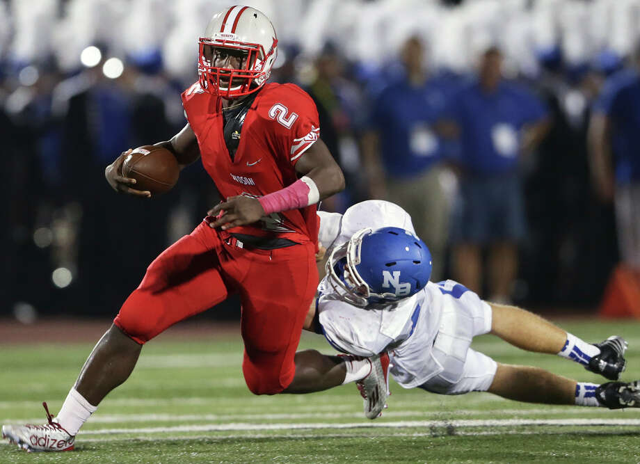 Judson quarterback Julon Williams gets away from New Braunfels would-be tackler Kolton Meneley during the Rockets' victory Friday night at Rutledge Stadium. Photo: Tom Reel / San Antonio Express-News