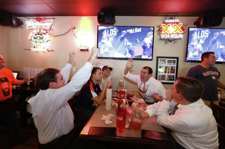 Astros fans Jake Fitzpatrick (left-right) Houston Walker, Jeff Walker, Andrew Hall and Daniel Marshall reacts as she watch early action Friday, October 9, 2015 at Pluckers Wing Bar, in Houston. Photo: Steve Gonzales, Houston Chronicle / © 2015 Houston Chronicle