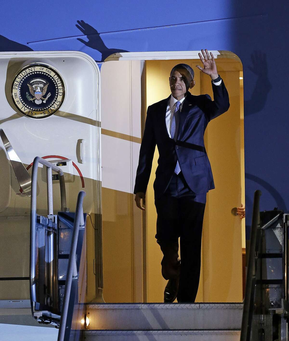 President Barack Obama waves as he exits Air Force One on Friday, Oct. 9, 2015, in San Francisco.