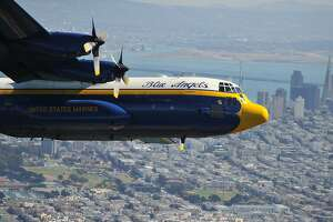 """The U.S. Navy Blue Angels' C-130T Hercules supply plane, nicknamed """"Fat Albert,""""  flies over the city during Fleet Week in San Francisco, California on October 9, 2015. """"Fat Albert"""" is used by the Blue Angels for logistics, carrying spare parts and support personal between shows.  AFP PHOTO/JOSH EDELSONJosh Edelson/AFP/Getty Images"""