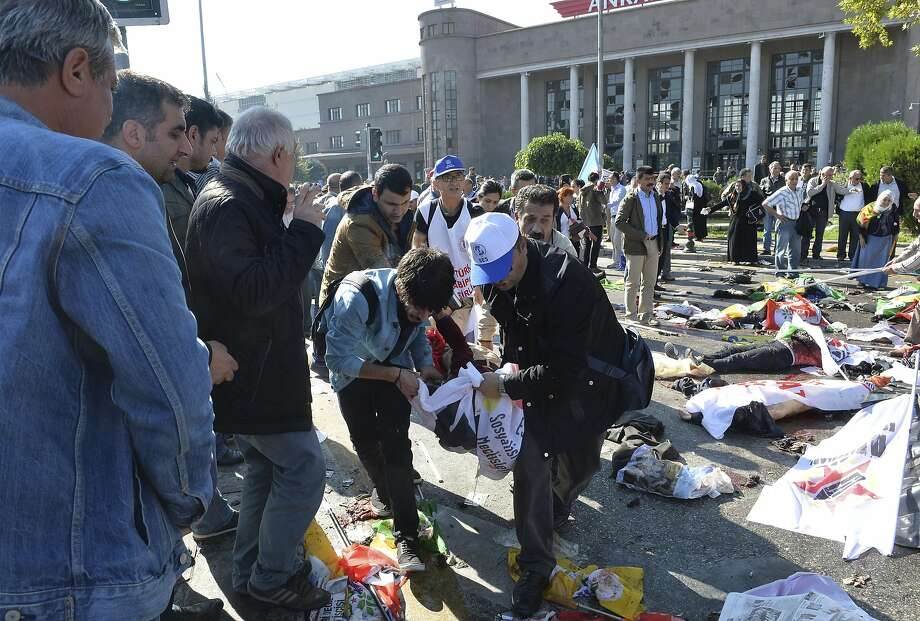 A victim is carried from the site of the blasts near Ankara's main train station. Two suspected suicide bombings occurred seconds apart, and health officials fear the death toll could rise. Photo: Associated Press