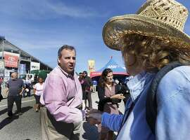 Republican presidential candidate, New Jersey Gov. Chris Christie shakes hands during a campaign stop with NASCAR fans at New Hampshire Motor Speedway before Sunday's Sprint Cup series auto race, Saturday, Sept. 26, 2015, in Loudon, N.H. (AP Photo/Jim Cole)