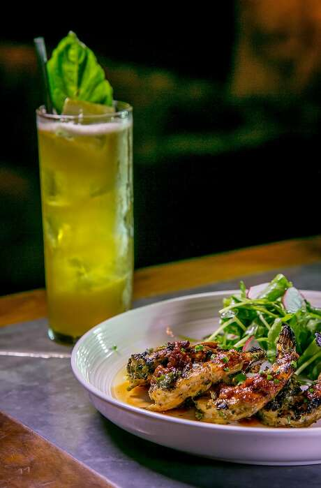 Zhoug grilled prawns ($16) with the Grand Bourbon Buck cocktail at Bergerac in S.F. Photo: John Storey, Special To The Chronicle