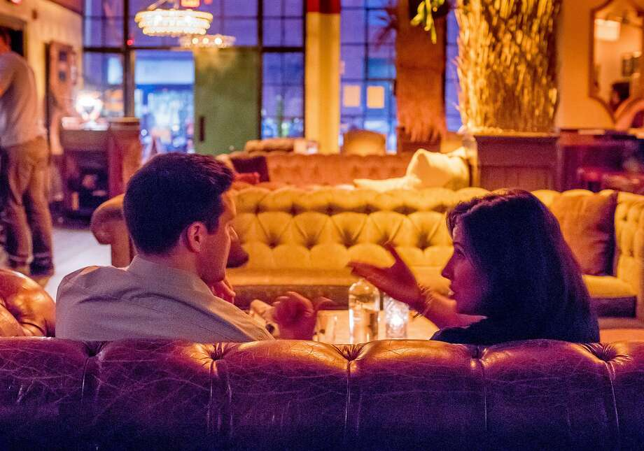 A couple has drinks on a couch in Bergerac in San Francisco, Calif. on Thursday, October 8th, 2015. Photo: John Storey, Special To The Chronicle