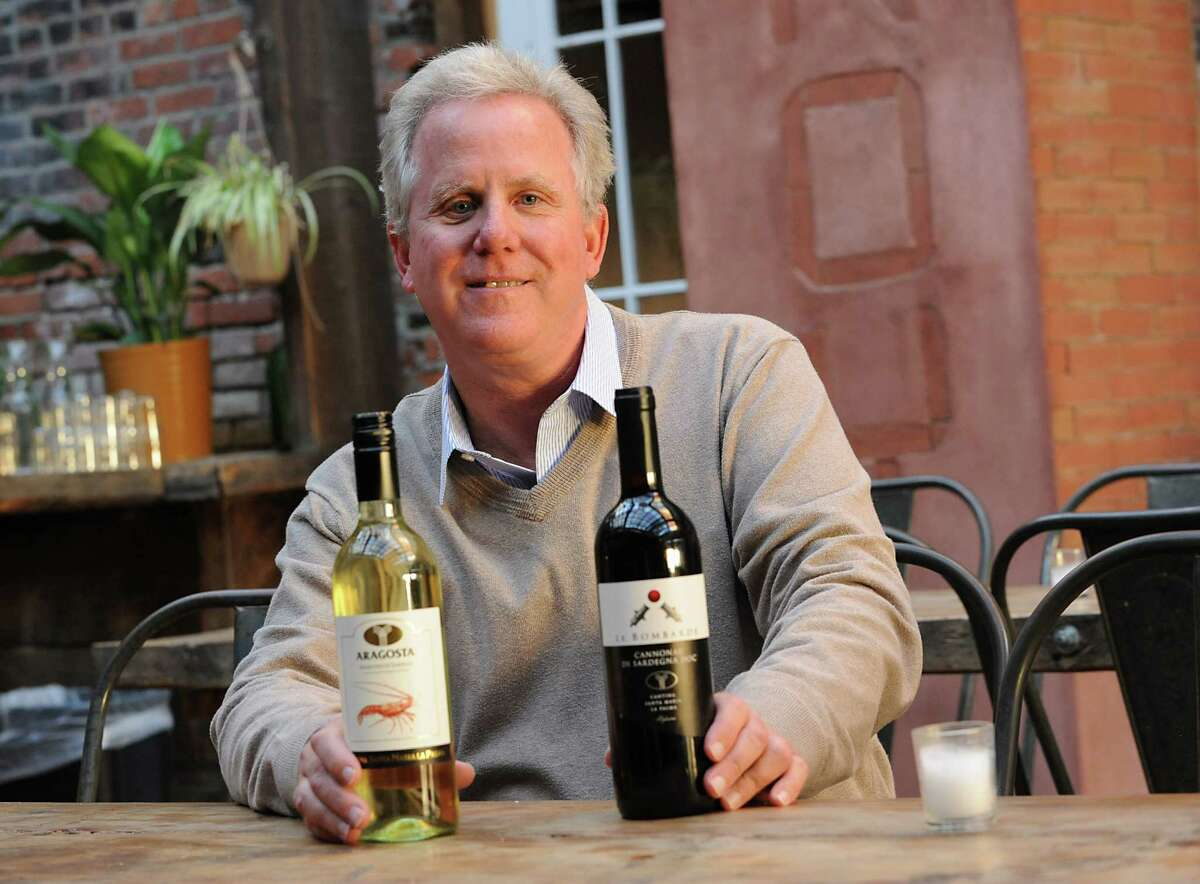 Wine importer Tony O'Haire with Aragosta Vermentino di Sardegna and Le Bomarde Cannonau di Sardegna Doc at Lucas Confectionery on Monday, Oct. 5, 2015 in Troy, N.Y. (Lori Van Buren / Times Union)