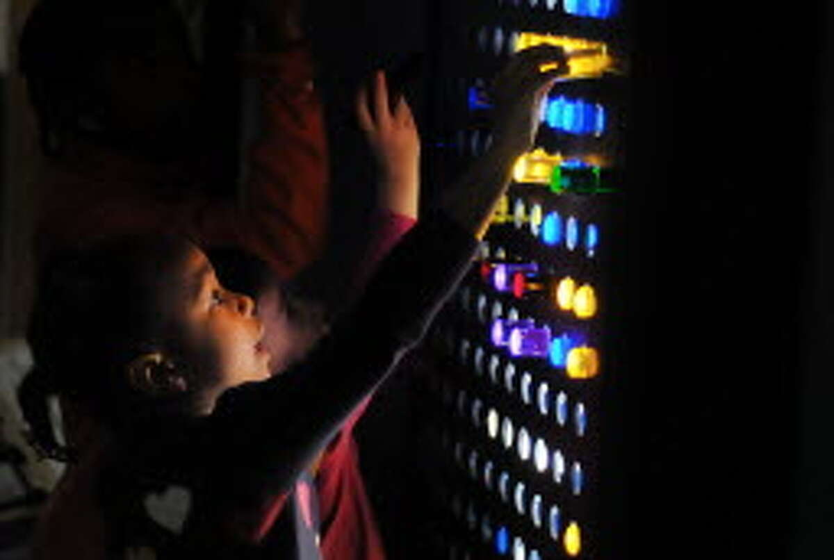 Sloan Harwell, 4, of Boston, Mass. plays with a giant lighted peg board during a New Year's celebration at the CNSE Children's Museum of Science and Technology on Wednesday, Dec. 31, 2014, in North Greenbush, N.Y. The children and adults rang in the new year at 12 noon during the event at the museum. (Paul Buckowski / Times Union)