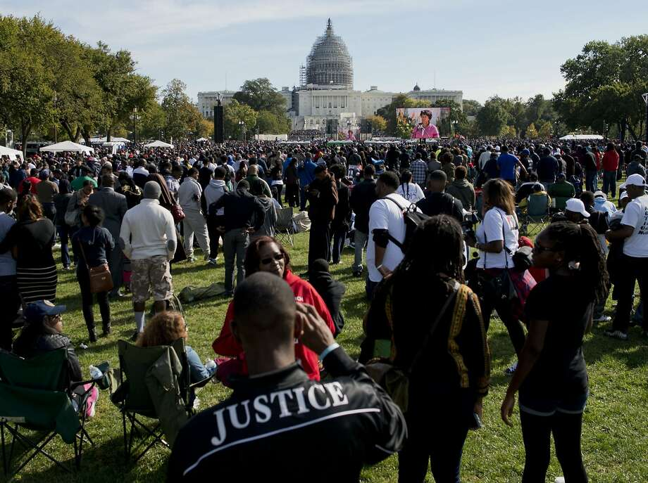 Observers gather on the National Mall on the 20th anniversary of the Million Man March. Photo: Andrew Caballero-reynolds, AFP / Getty Images