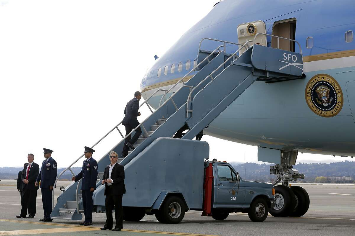 President Barack Obama boards Air Force One at the San Francisco International Airport in San Francisco, California, on Saturday, Oct. 10, 2015.
