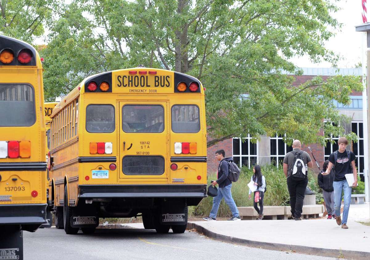 School buses during afternoon dismissal at Greenwich High School in Greenwich, Conn., Thursday, Oct. 8, 2015.