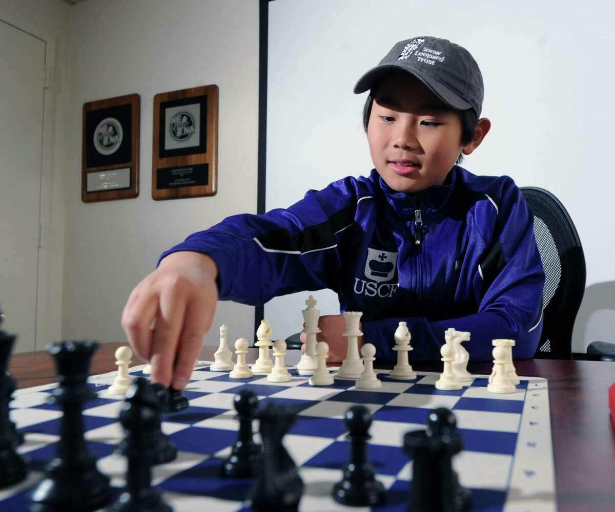 Max Lu, a 10-year old Whitby School student, seen here at the Greenwich Time, Friday, Oct. 2, 2015, has become the youngest chess player to earn the master rating in U.S. Chess Federation history.
