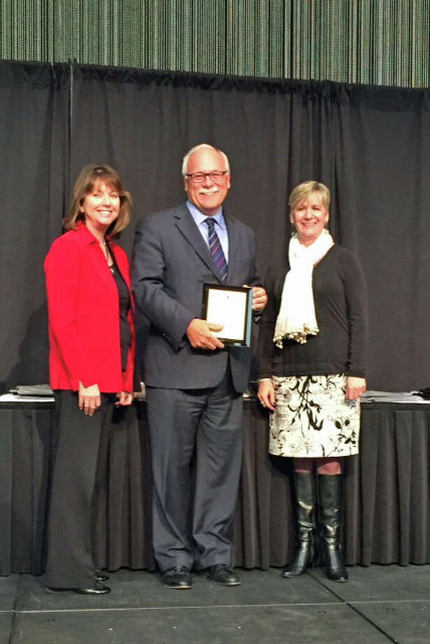 The Connecticut Economic Resource Center Inc. and Eversource received a Gold Excellence in Economic Development Award from the International Economic Development Council for its Connecticut Economic Review publication in the category of General Purpose Print Brochure for communities with populations of greater than 500,000. The honor was presented at an awards ceremony during the 2015 IEDC Annual Conference, which was held this week in Anchorage, Alaska. Photo: Contributed / Contributed Photo / Greenwich Time Contributed