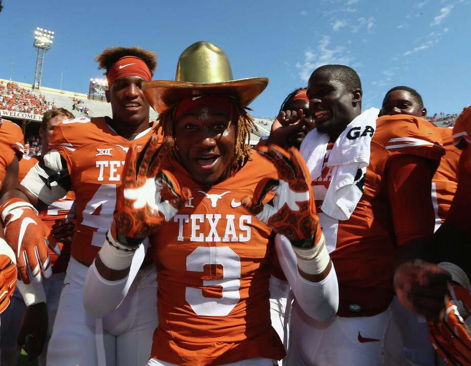 DALLAS, TX - OCTOBER 10:  Armanti Foreman #3 of the Texas Longhorns celebrates with the Golden Hat trophy after a 24-17 win against the Oklahoma Sooners during the 2015 AT&T Red River Showdown at Cotton Bowl on October 10, 2015 in Dallas, Texas. Photo: Ronald Martinez, Getty Images / 2015 Getty Images