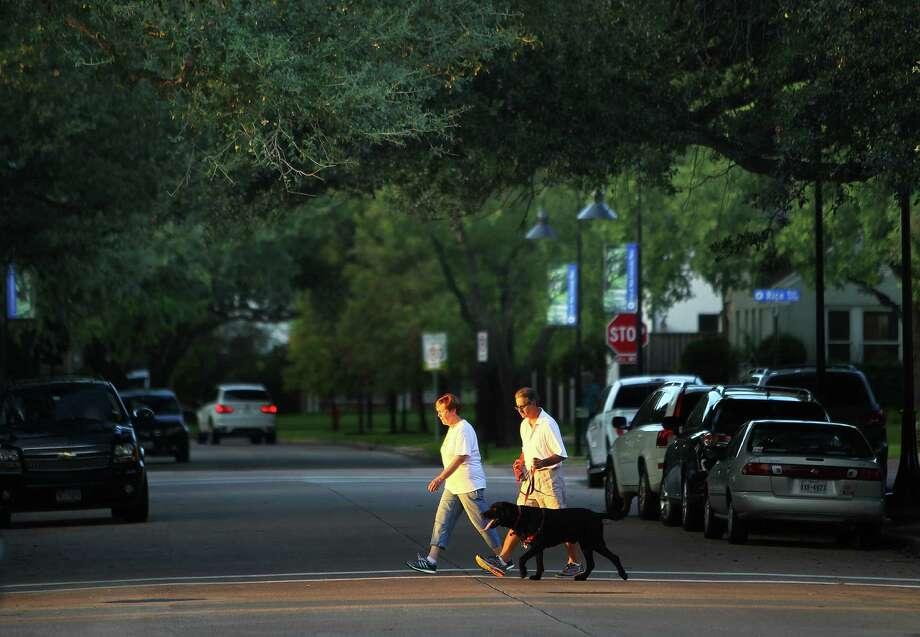 Residents cross Auden Street in West University Place, Tuesday, Sept. 29, 2015. Photo: Mark Mulligan, Houston Chronicle / © 2015 Houston Chronicle