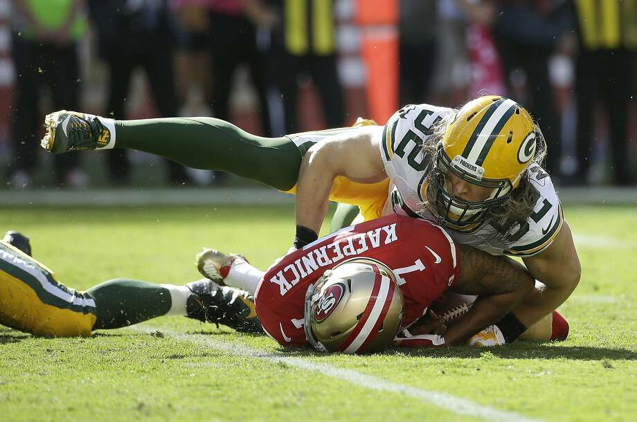 Colin Kaepernick was sacked six times by the Packers last week, including this one by Clay Matthews. The 49ers have allowed the third-most sacks (14) in the NFL. Photo: Marcio Jose Sanchez, Associated Press