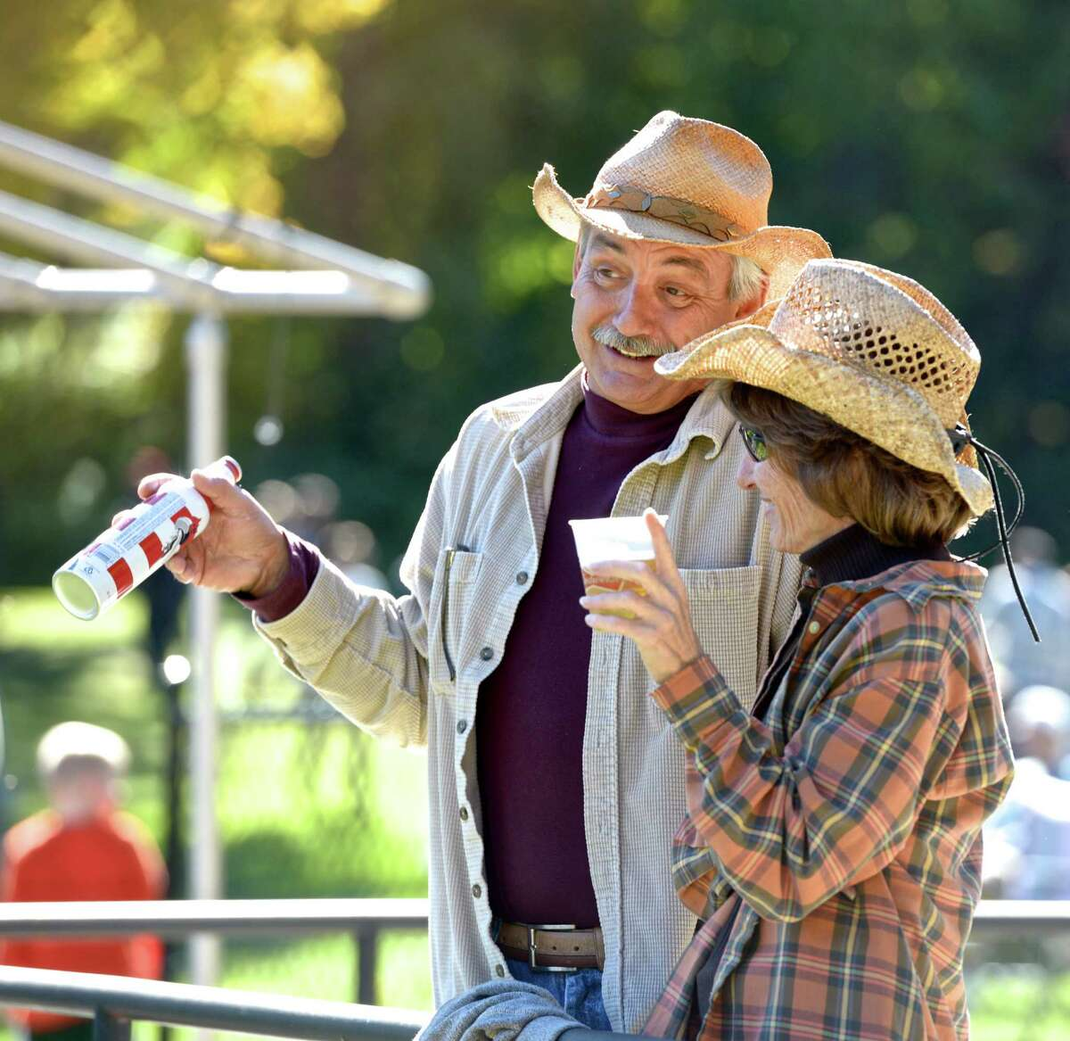 """Joyce Peters, of Patterson, NY, and Michael Geraci, of North Branford, listen to the band """"Forgotten by Friday"""" at Ives Concert Park, on Saturday, October 10, 2015, in Danbury, Conn. Peters and Geraci were on a first date at the 1st Annual """"Harvest Jam"""" festival at the park."""