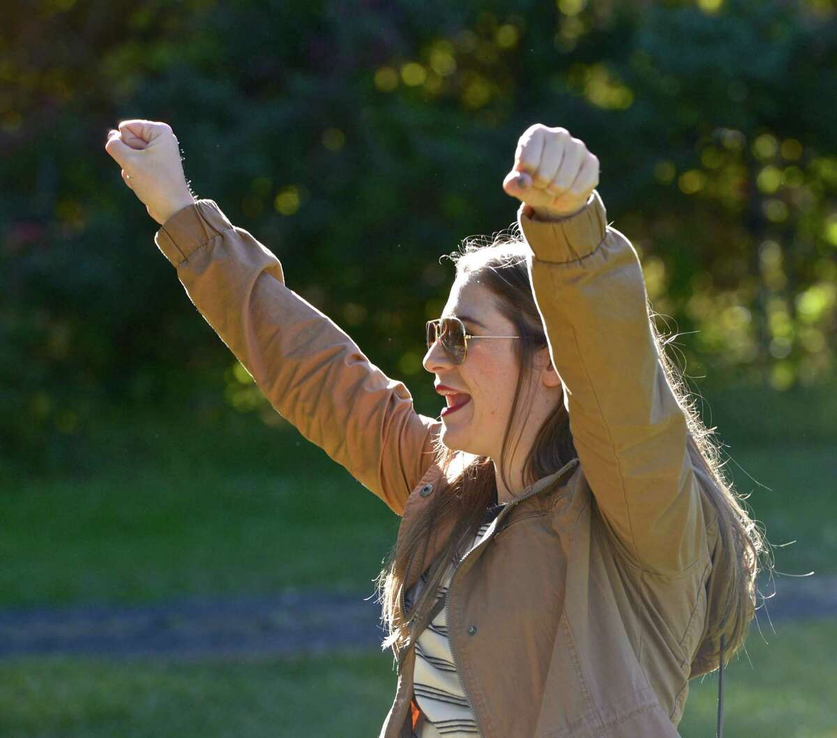 """Laura Richards, of Ridgefield, celebrates a score in the game of """"Corn Hole"""" she was playing with her friends at Ives Concert Park, on Saturday, October 10, 2015, in Danbury, Conn. They were at the park, on Western Connecticut State University's Westside Campus, for the 1st Annual """"Harvest Jam""""."""