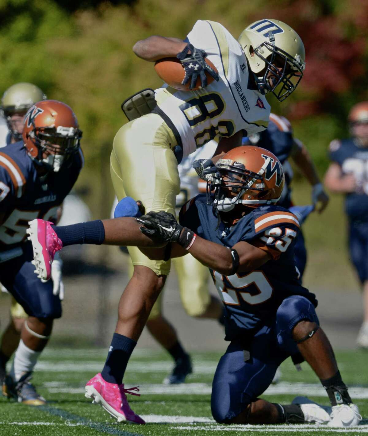 Western's Equan Brooks (25) stops Maritime's Adrell Enlow (88) on a kickoff return in the Western Connecticut State University football game against Massachusetts Maritime Academy, on Saturday, October 10, 2015, on Western's Westside Campus, in Danbury, Conn.
