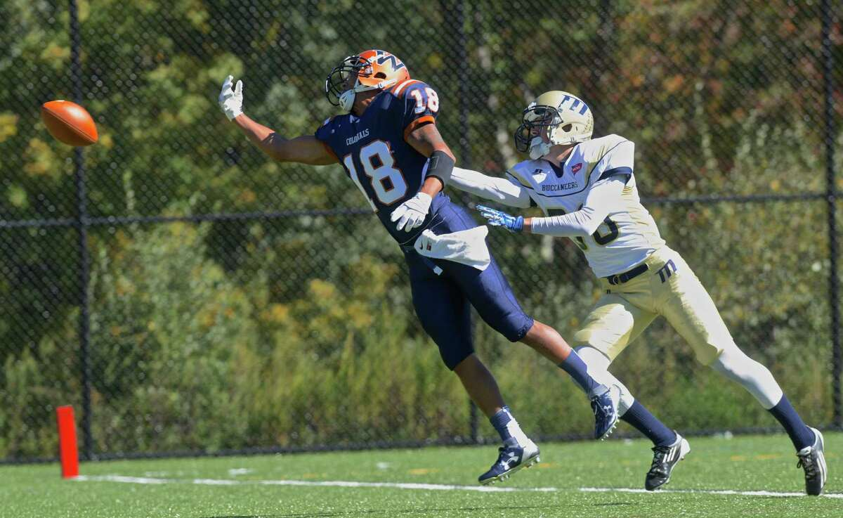 The pass is just out of the reach of Western's William Andrew (18) while being defended by Maritime's Liam Corkery (30), at the goal line, in the Western Connecticut State University football game against Massachusetts Maritime Academy, on Saturday, October 10, 2015, on Western's Westside Campus, in Danbury, Conn.