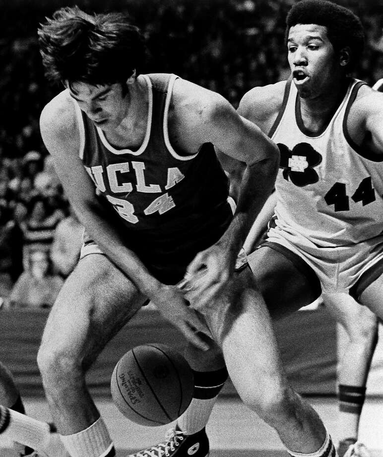 Dave Meyers of UCLA looks for the ball after losing it against Notre Dame's Adrian Dantley during a January 1974 game. Photo: Associated Press