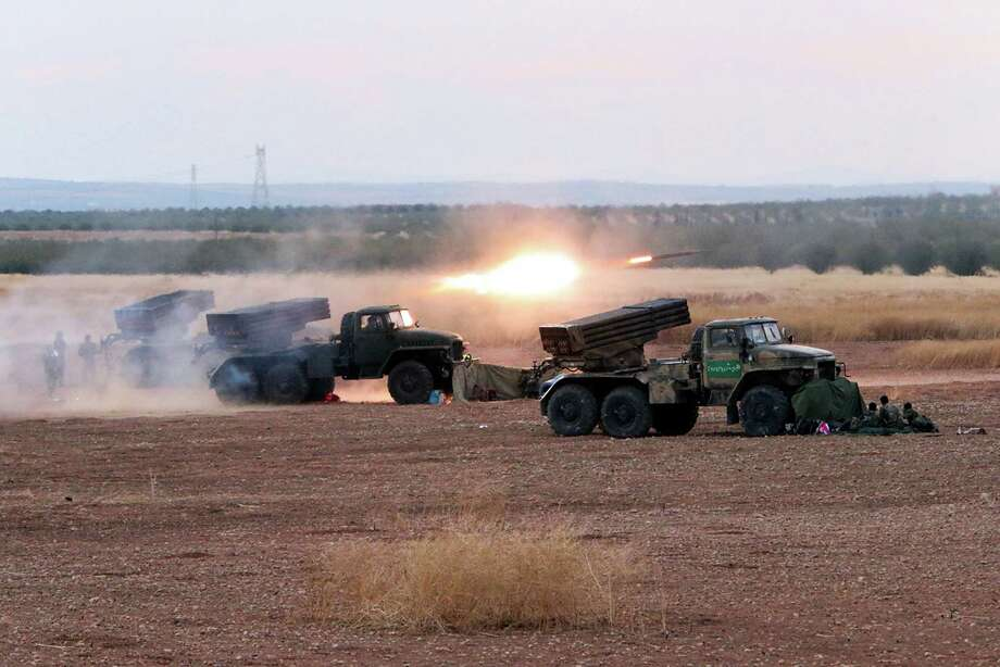 In this photo taken on Wednesday, Oct.  7, 2015, Syrian army rocket launchers fire near the village of Morek in Syria. The Syrian army has launched an offensive this week in central and northwestern Syria aided by Russian airstrikes. CIA-backed rebels in Syria, who had begun to put serious pressure on President Bashar Assad's forces, are now under Russian bombardment with little prospect of rescue by their American patrons, U.S. officials say. Over the past week, Russia has directed parts of its air campaign against U.S.-funded groups and other moderate opposition in a concerted effort to weaken them, the officials say.  (AP Photo/Alexander Kots, Komsomolskaya Pravda, Photo via AP) Photo: Alexander Kots, STR / www.kp.ru